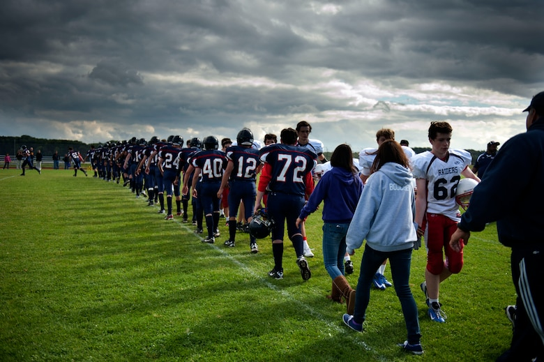 BITBURG ANNEX, Germany –Barons players shake hands with their opponents after their homecoming game against the Raiders at Bitburg High School Sept. 29.  The Barons have won the last three Department of Defense European Division II championships and are undefeated this year. (U.S. Air Force photo by Airman 1st Class Gustavo Castillo/Released)