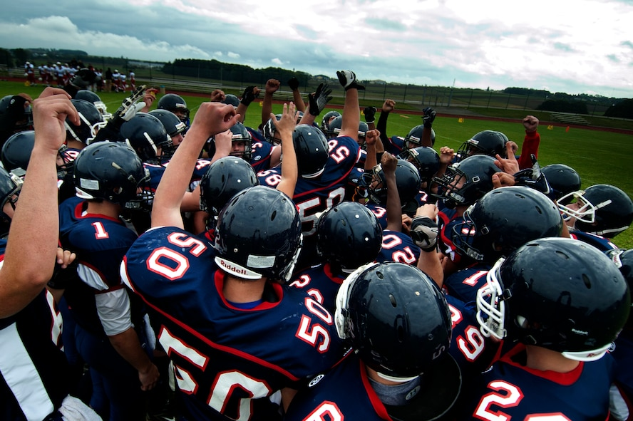 BITBURG ANNEX, Germany – The Bitburg Barons motivate each other before their game against the International School of Brussels Raiders at Bitburg High School Sept. 29.  The referees stopped the homecoming game at the half after the Barons achieved a commanding lead of 42-0. (U.S. Air Force photo by Airman 1st Class Gustavo Castillo/Released)