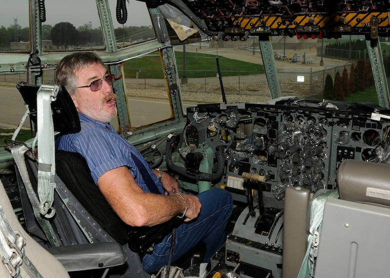 Mr. Christopher Schutz, a former crew chief who served in Vietnam, sits in the flight deck of a C-130E Hercules on display at the Air Park at the 182nd Airlift Wing in Peoria, Ill. on Sep. 26, 2012. (U.S. Air Force photo by Tech. Sgt. Todd Pendleton/Released.)