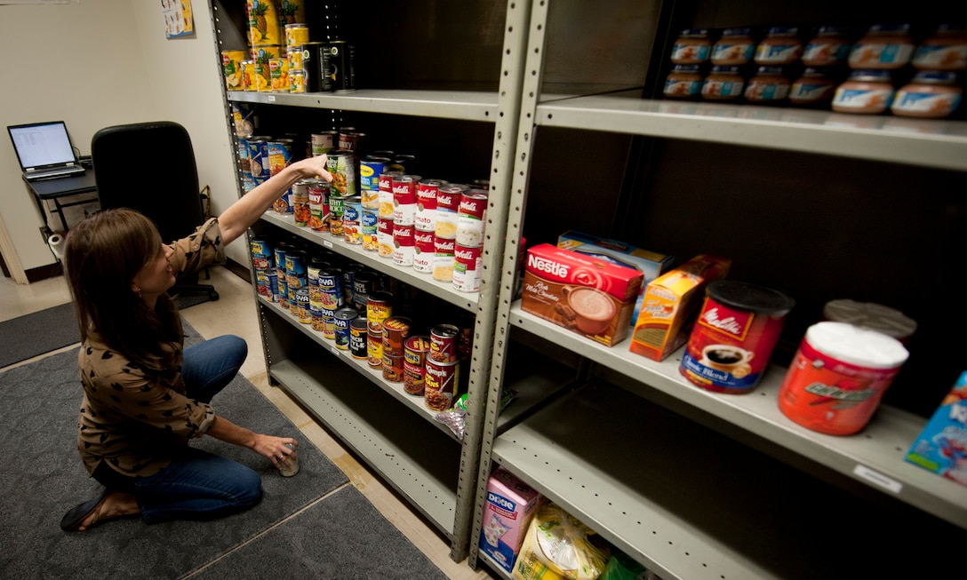 YOKOTA AIR BASE, Japan -- Annie Boerm, Air Force Sergeants Association food bank volunteer, stocks shelves with food Oct. 4, 2012, at Yokota Air Base, Japan. The AFSA food bank gives food to any Department of Defense card holder in need. (U.S. Air Force photo by Airman 1st Class Krystal Garrett)