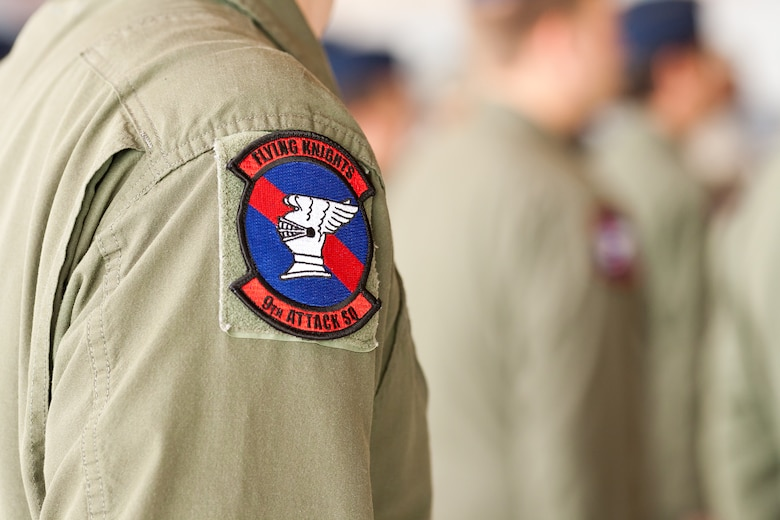 An Airman in the 9th Attack squadron wears the Flying Knights' patch at Holloman Air Force Base, N.M., Sept. 28. The 9th Attack Squadron was re-activated as a remotely piloted aircraft training squadron on Sept. 28. The Flying Knights have a rich history dating back to World War II when Medal of Honor recipient Maj. Richard Bong flew in the 9th Fighter Squadron. (Courtesy photo)