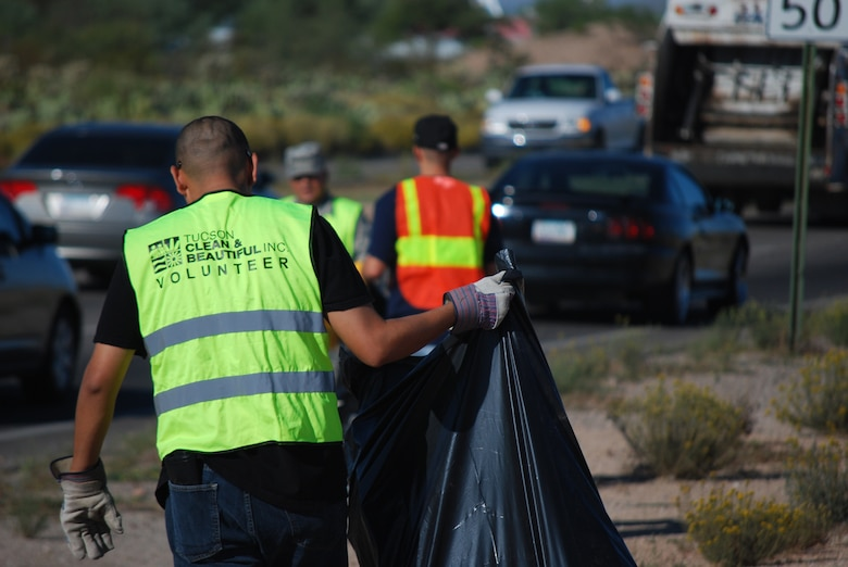 Members of 12th Air Force (Air Forces Southern) volunteer as part of the Tucson Clean and Beautiful program to clear area roadways of trash and debris Oct. 4. More than 20 volunteers participated in the program, clearing a mile-long stretch of highway near the Pima Air Museum in Tucson, Ariz.  12th AF (AFSOUTH), based at nearby Davis-Monthan AFB, is responsible for the combat readiness of 10 active-duty wings by preparing Airmen and more than 730 aircraft for worldwide deployments, including in direct support of combat operations in Afghanistan.  In the organization's AFSOUTH role, Airmen plan and coordinate U.S. Air Force involvement and partnership building efforts throughout Central America, South America and the Caribbean.  (U.S. Air Force photo by Capt. Justin Brockhoff/Released)