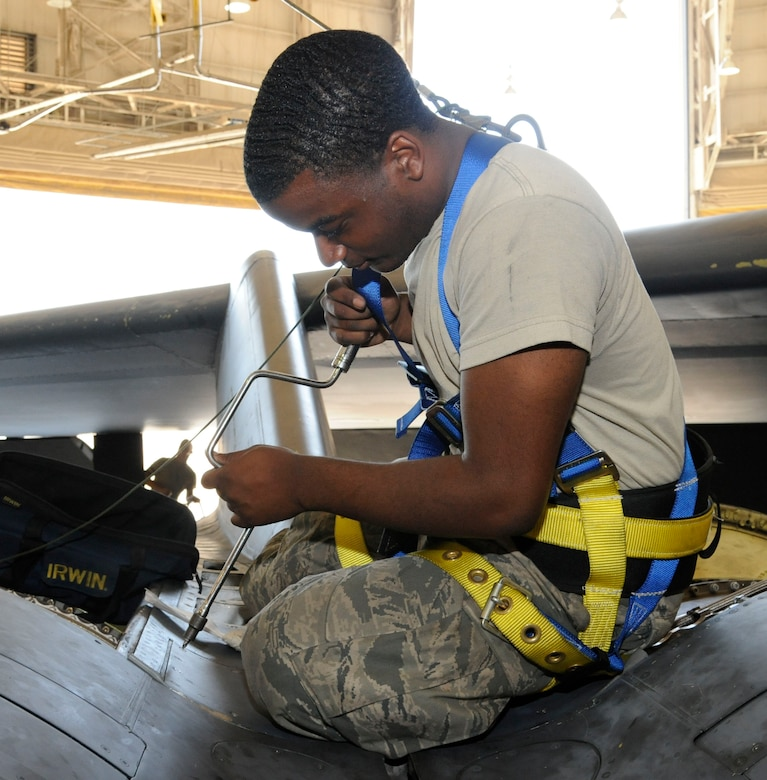 Airman 1st Class Mikel Stevens, 2nd Maintenance Squadron accessories flight electrical and environmental section, installs a valley panel on a B-52H Stratofortress on Barksdale Air Force Base, La., Oct. 4. Valley panels cover critical parts of the engine, this area contains the anti-icing units which prevent the engines from seizing up at high altitudes. Installation and repair to vital areas such as these are one of the areas of expertise E and E Airmen must obtain to ensure the Barksdale mission runs successfully. (U.S. Air Force photo/Airman 1st Class Andrew Moua)(RELEASED)