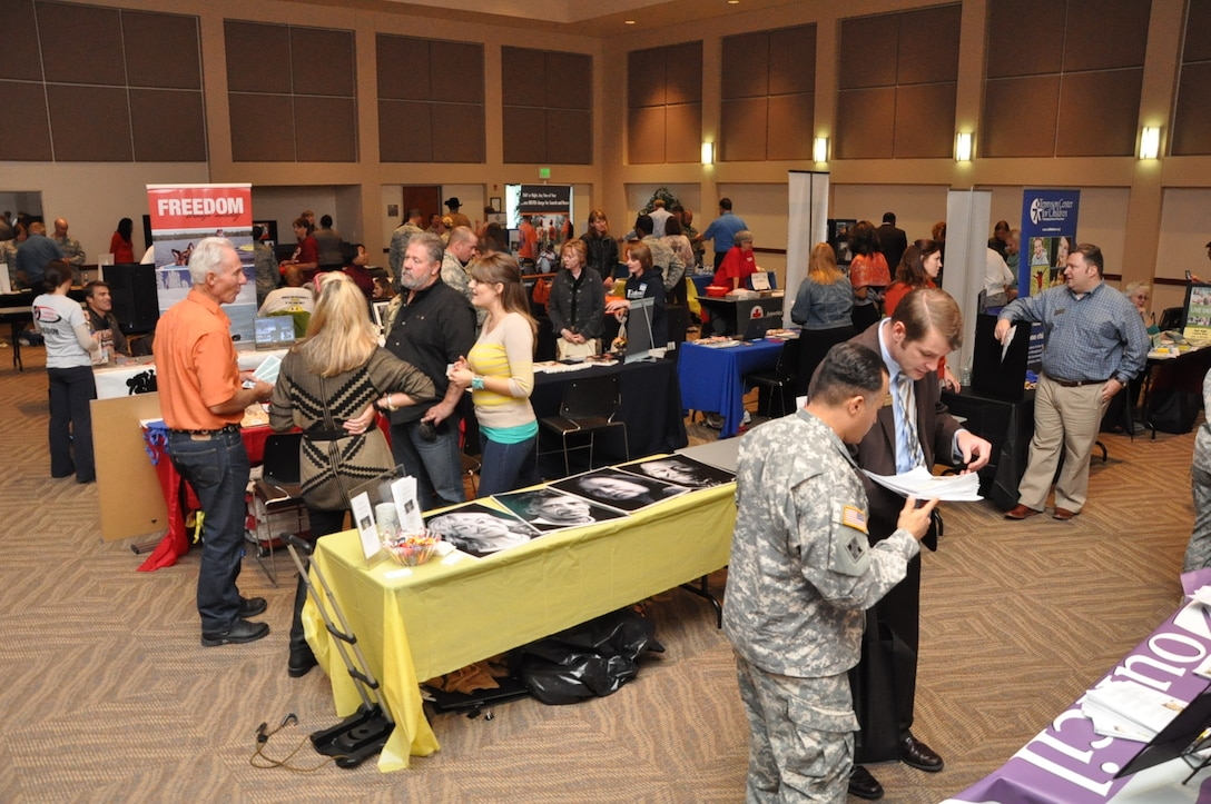 BUCKLEY AIR FORCE BASE, Colo. – Team Buckley members wander through a sea of representatives from approximately 70 charities during the Buckley Combined Federal Campaign kick-off event Oct. 4, 2012, at the Leadership Development Center. The CFC goal is to make 100-percent contact with potential contributors, while the base goal is to have 30-percent participation for Team Buckley members. (U.S. Air Force photo by Staff Sgt. Kali L. Gradishar)
