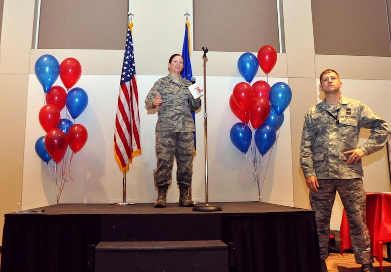 BUCKLEY AIR FORCE BASE, Colo. – Col. Tracey Hayes, 460th Space Wing vice commander, thanks Team Buckley members and representatives of approximately 70 charities for attending the Buckley Combined Federal Campaign kick-off event while Master Sgt. Bradley Moses, 460th Security Forces Squadron first sergeant and CFC volunteer, stands by Oct. 4, 2012, at the Leadership Development Center. The CFC is scheduled to run through Nov. 22 with goals to reach 100-percent contact and 30-percent participation. (U.S. Air Force photo by Staff Sgt. Kali L. Gradishar)
