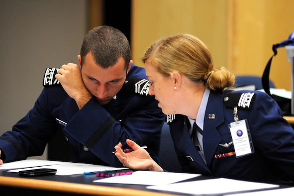 Cadet 2nd Class Michael Whiteside and Cadet 1st Class Harriet Randolph confer at the Air Force Academy's 50th Forensics Classic Sept. 22, 2012. The tournament brought together nearly 300 competitors from 29 colleges in 18 states. (U.S. Air Force photo/Mike Kaplan)
