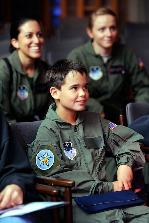 Wyatt Denton listens to a briefing during his visit to the Air Force Academy Sept. 28, 2012. Wyatt, a native of Parker, Colo., was made a cadet for a day through the Academy's partnership with the Make-a-Wish Foundation. (U.S. Air Force photo/Sarah Chambers)