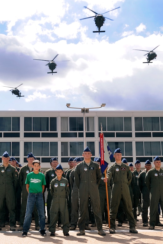 Wyatt Denton (center) and his brother Joe (left) stand on the Terrazzo with Cadet Squardron 32, Sept. 28. HH-60 Pave Hawk helicopters from the 34th Weapons Squadron at Nellis Air Force Base, Nev., flew over the noon meal formation. Wyatt is a native of Parker, Colo. (U.S. Air Force photo/Sarah Chambers)