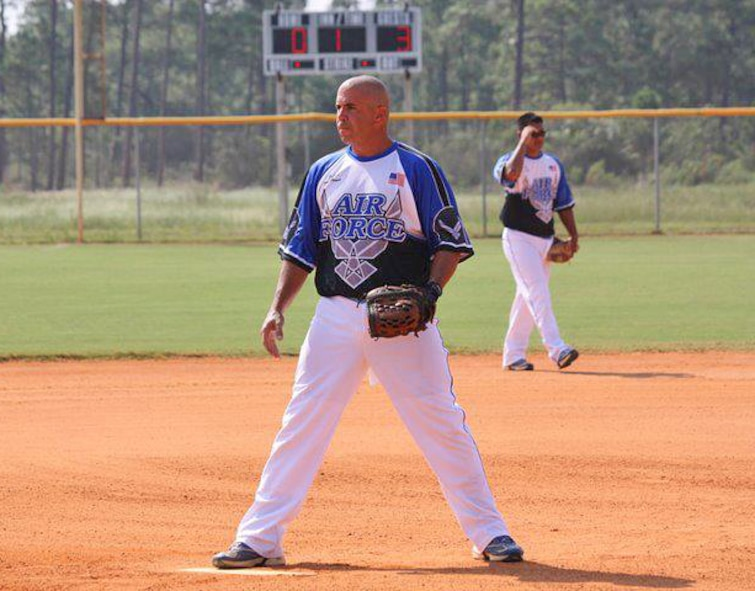 Master Sgt. Tony Patrick, 4th Equipment Maintenance Squadron NCO in charge of munitions inspections, warms up prior to an Air Force men's softball game. Patrick typically pitches for his teams but also plays shortstop. (Courtesy Photo)