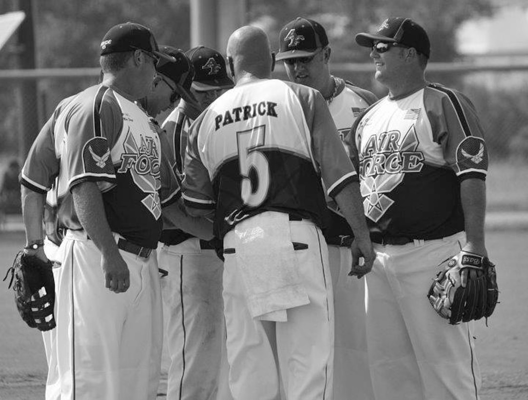 Master Sgt. Tony Patrick, 4th Equipment Maintenance Squadron NCO in charge of munitions inspections, rallies teammates during an Air Force softball game. Patrick has played on the Air Force men's team for 10 years, more than any other player. (Courtesy Photo)