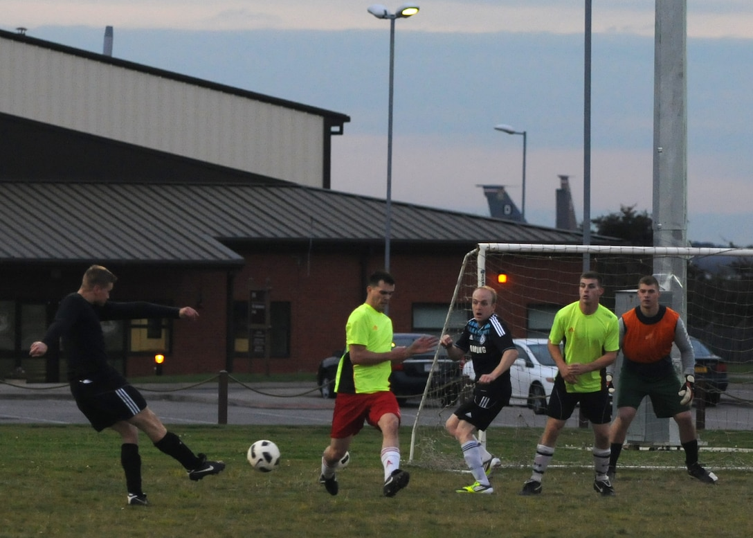 Senior Airman Justin Wood, 100th Security Forces Squadron, scores a goal for his team during the first of two soccer matches against the 100th Civil Engineer Squadron Oct. 4, 2012, at RAF Mildenhall, England. The final score of each match was 2 to 1 with the 100th SFS sweeping both games to claim the title of Team Mildenhall intramural soccer champions. (U.S. Air Force photo by Tech. Sgt. Neal X. Joiner/Released)