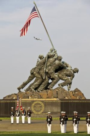 U.S. Marines of Marine Barracks Washington perform during a wreath laying ceremony in honor of the Marine Corps Aviation Centennial at the Marine Corps War Memorial in Arlington, Va., May 16, 2012.