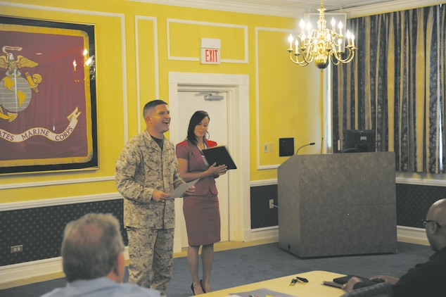 Col. Yori R. Escalante, chief of staff, and Staff Sgt. Juana L. DeLosSantos, equal opportunity advisor, both with Marine Corps Logistics Command, present certificates to class members at the Senior Leaders Workshop at the base Conference Center, Sept 26.