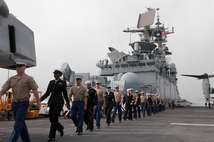 20121003-M-IO267-144  SAN FRANCISCO - U.S. Marines and Sailors with the 13th Marine Expeditionary Unit march atop the flight deck of the USS Makin Island (LHD-8) prior to arriving in San Francisco for the 2012 Fleet Week, Oct 3, 2012. From Oct. 3-8, Marines and Sailors of the 13th MEU, I Marine Expeditionary Brigade, will participate in numerous community outreach events including the Italian Heritage Day parade, urban search and rescue demonstration, park restoration projects and hospital visits.   (U.S. Marine Corps photo by Lance Cpl. David Gonzalez/Released)