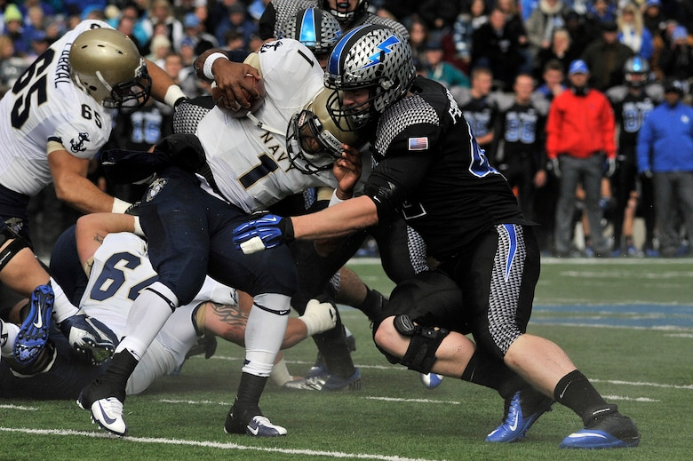 Air Force senior linebacker Austin Niklas stops Navy quarterback Trey Miller during the Navy-Air Force game at Falcon Stadium Oct. 6, 2012. The Midshipmen defeated the Falcons in overtime, 28-21. (U.S. Air Force photo/Mark Watkins)