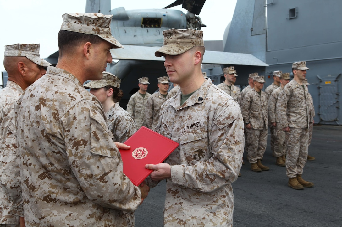 Sgt. Michael Cox, a Brighton Ill., native with the Command Element, 24th Marine Expeditionary Unit, is promoted to his current rank of Sergeant in the US Marine Corps by Col. Frank Donovan, commanding officer of the 24th MEU during a ceremony aboard the USS Iwo Jima (LHD 7), Oct 1, 2012.  The 24th MEU is deployed with the Iwo Jima Amphibious Ready Group as a theater reserve force for U.S. Central Command and is providing support for maritime security operations and theater security cooperation efforts in the U.S. Navy's 5th Fleet area of responsibility. (U.S. Marine Corps photo by Gunnery Sgt. Chad R. Kiehl)