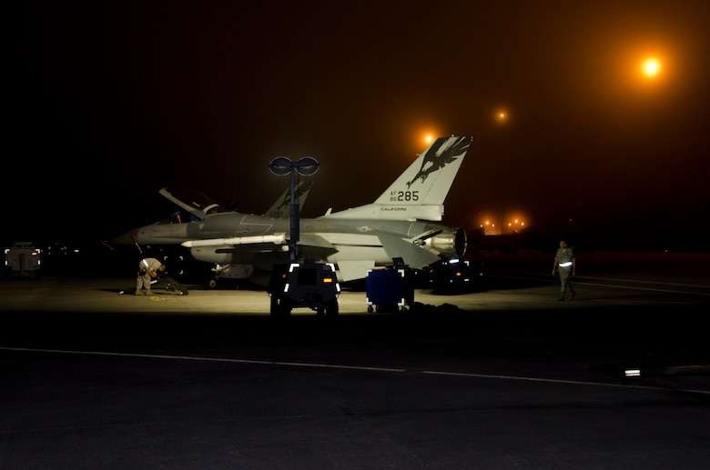 Airmen from the 144th Fighter Wing prep an F-16C Fighting Falcon's for an early morning training mission during Combat Archer, a weapon systems academics exercise, at Tyndall AFB, Florida, October 9, 2012.( Air National Guard photo by Tech. Sgt. Charles Vaughn)