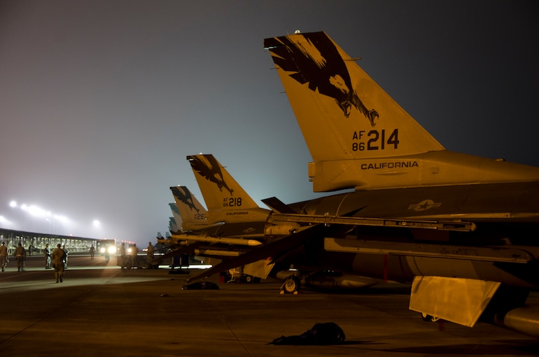 Airmen from the 144th Fighter Wing prep F-16C Fighting Falcon's for an early morning training mission during Combat Archer, a weapon systems academics exercise, at Tyndall AFB, Florida, October 9, 2012.