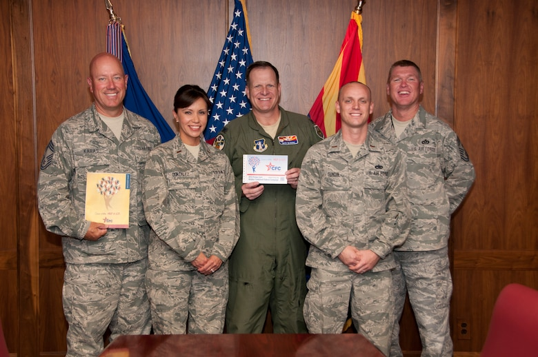 """Chief Master Sgt. Brian Karas, 2Lt. Melissa Gonzalez, Col. """"Mick"""" McGuire (162 FW/CC), 2Lt. Carl Sundin and Command Chief Master Sgt. Shane Clark kick off the 2012 Combined Federal Campaign (CFC)"""