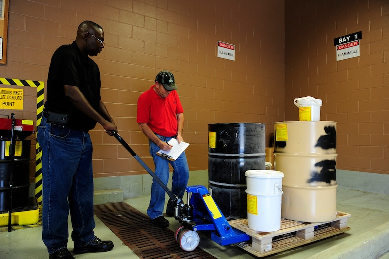 Darryl Keith (left) and Rodney Greene, Shaw Air Force Base central accumulation point environmental technicians, move and inventory hazardous items so they can be properly documented and stored before being disposed of at Shaw AFB, S.C., Oct. 5, 2012. The central accumulation point recycles otherwise unusable materials, saving the environment and citizens from their toxic effects, while also creating revenue for the government by reusing the recycled materials. (U.S. Air Force photo by Airman 1st Class Daniel Blackwell/Released)