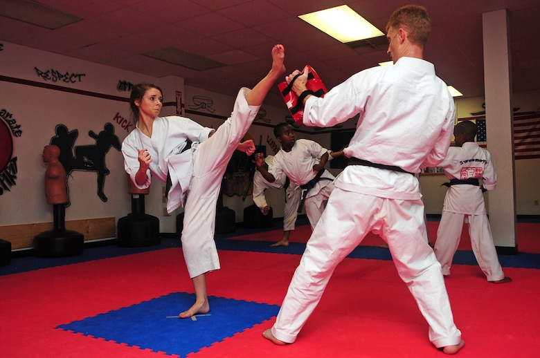 Aerial Vineyard, 15, performs a roundhouse kick during her karate practice in Goldsboro, N.C., Oct. 2, 2012. The teen earned two gold medals in kata and weapons fighting, and one silver in sparring during this year's Junior Olympics. Aerieal is the daughter of Tech. Sgt. Michael Vineyard, 335th Aircraft Maintenance Unit flight line expeditor. (U.S. Air Force photo/Airman 1st Class Aubrey Robinson/Released)