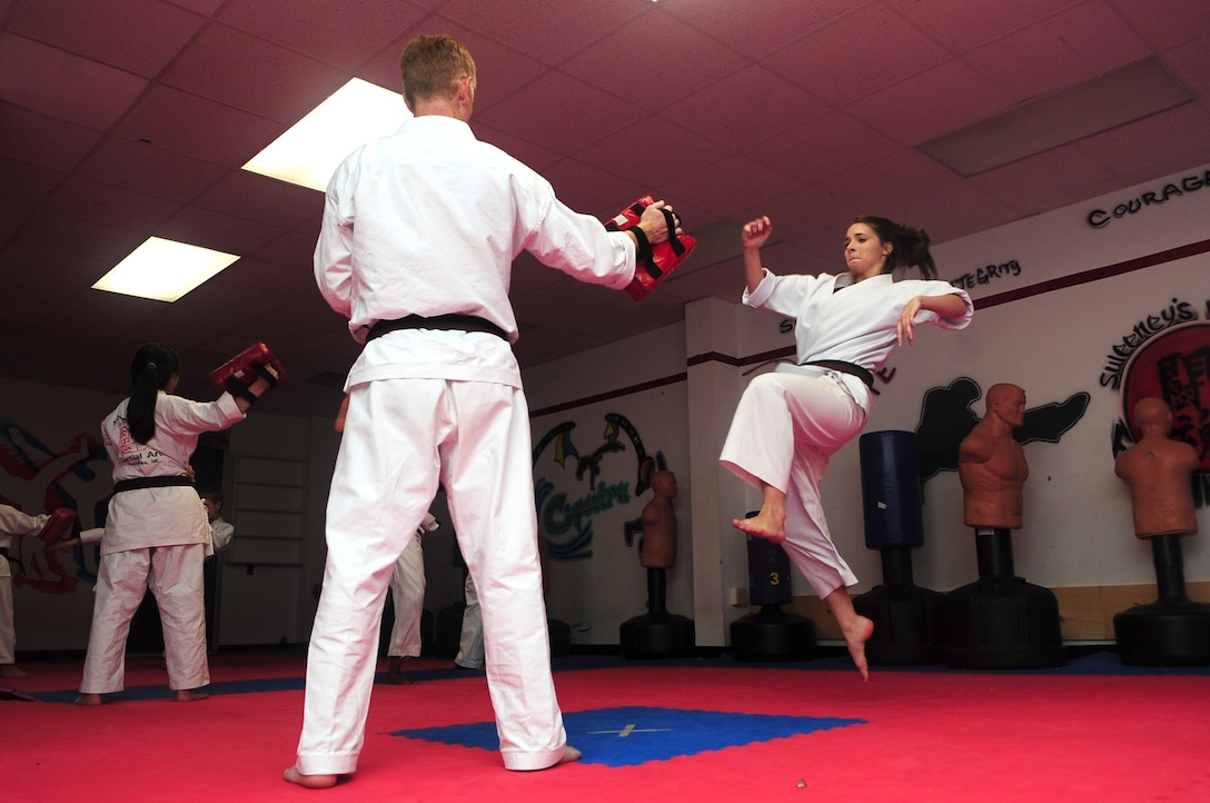 Aerial Vineyard, 15, performs a jumping roundhouse kick during her karate practice in Goldsboro, N.C., Oct. 2, 2012. The karate student earned two gold and one silver medal competing against other students from around the United States at this year's Junior Olympics. Aerieal is the daughter of Tech. Sgt. Michael Vineyard, 335th Aircraft Maintenance Unit flight line expeditor. (U.S. Air Force photo/Airman 1st Class Aubrey Robinson/Released)