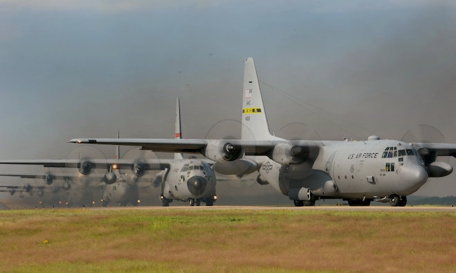 C-130s line the runway before a flight Oct. 3, 2012, at Little Rock Air Force Base, Ark. The aircraft were part of a 14-ship formation.  (U.S. Air Force photo by Staff Sgt. Jessica Condit)