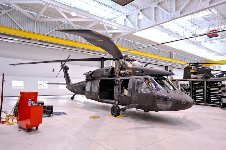 BUCKLEY AIR FORCE BASE, Colo. – Members of the Colorado Army National Guard's Army Aviation Support Facility performs maintenance on a UH-60 Black Hawk Oct. 4, 2012. The AASF ensures their fleet, consisting of Boeing CH-47 Chinooks, UH-60 Black Hawks, UH-72 Lakotas and a C-26 Metroliner, are ready for missions that include fighting wildfires, search-and-rescue, law enforcement support, reconnaissance of natural disasters, VIP transport, hay drops for stranded livestock and anything else the governor may request. (U.S. Air Force photo by Senior Airman Christopher Gross)