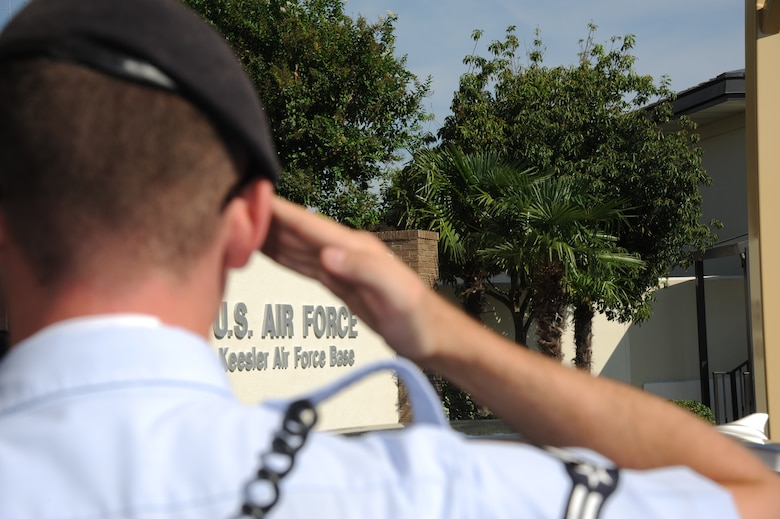 Airman 1st Class Chad Byrne, 81st Security Forces Squadron, salutes an officer as he enters one of the gates at Keesler Air Force Base, Miss., Oct. 4, 2012. Keesler is the only base in Air Education and Training Command to adopt an elite gate guard program. The program increases pride and discipline within the 81st SFS while creating a positive, lasting impression in the local community. (U.S. Air Force photo by Kemberly Groue)