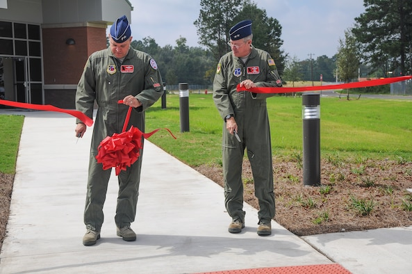 National Guard Maj. Gen. Jim Butterworth, Adjutant General of Georgia, and National Guard Maj. Gen. Thomas Moore, Georgia Air National Guard Commander, cut the ceremonial ribbon dedicating the 165th Air Support Operations Squadron's new building, Oct, 10, 2012 at Savannah Air National Guard base in Garden City, Ga. The 165th ASOS relocated from Brunswick, Ga. to the new location in Garden City, Ga. (National Guard photo by Tech. Sgt. Charles Delano/released)