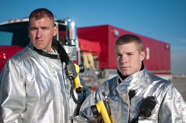 Staff Sgts. Damon Williams (left) and Jeffrey Sawmiller, 124th CEF, and the 4,000 gallon water tender responded to the off-base house fire that was caused by a charcoal grill Sept. 23.