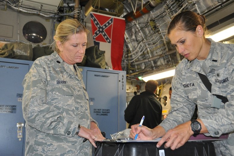 Lt. Col. Linda Berry (left) and 1st Lt Deborah Lichota, medical technicians assigned to the 86th Aeromedical Squadron at Ramstein Air Base, Germany, review each patient's record and status aboard a C-17 Globemaster II before it departs during the final leg of a MEDEVAC flight from Ramstein to the United States.  The Air Force's Strategic Transitory Care process ensures wounded warriors are kept safe and receive consistent care throughout the journey from Afghanistan through Germany to the United States. (U.S. Air Force photo/TSgt Shawn David McCowan)