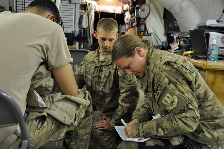 1st Lt. Rachel Hinson, a Registered Nurse at Bagram's Contingency Aeromedical Staging Facility, and SrA Christopher Foster, a patient care technician, check a CASF patient's vital signs and update his records prior to his departure for Ramstein Air Base, Germany. The Air Force's Strategic Transitory Care process ensures wounded warriors are kept safe and receive consistent care throughout the journey from Afghanistan through Germany to the United States. (U.S. Air Force photo/TSgt Shawn David McCowan)
