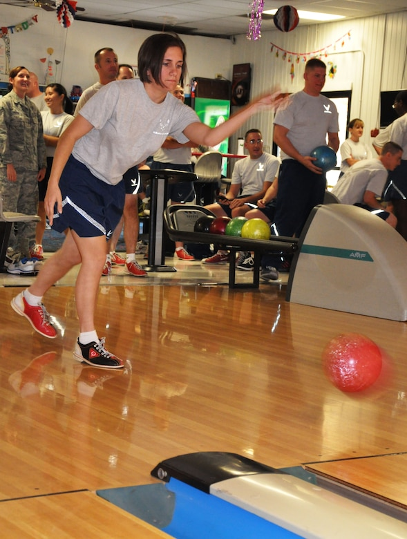 Senior Airman Hayley Lambert, 9th Communications Squadron, competes in the reverse-hand bowling portion of Beale Air Force Base's annual sports day Oct. 5. (U.S. Air Force photo by Tech. Sgt. Eric Petosky/Released)