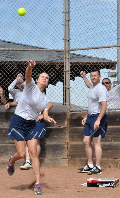1st Lt. Jennifer Galuanin, 548th Operations Support Squadron, competes in the softball throw portion of Beale Air Force Base's annual sports day Oct. 5. (U.S. Air Force photo by Tech. Sgt. Eric Petosky/Released)