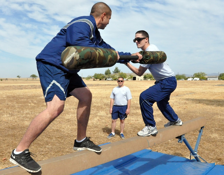 Senior Airman Adam Bright (left), 9th Communications Squadron, and Senior Airman Joshua Craig, 9th Civil Engineer Squadron, face off in the jousting competition portion of Beale Air Force Base's annual sports day Oct. 5. (U.S. Air Force photo by Tech. Sgt. Eric Petosky/Released)
