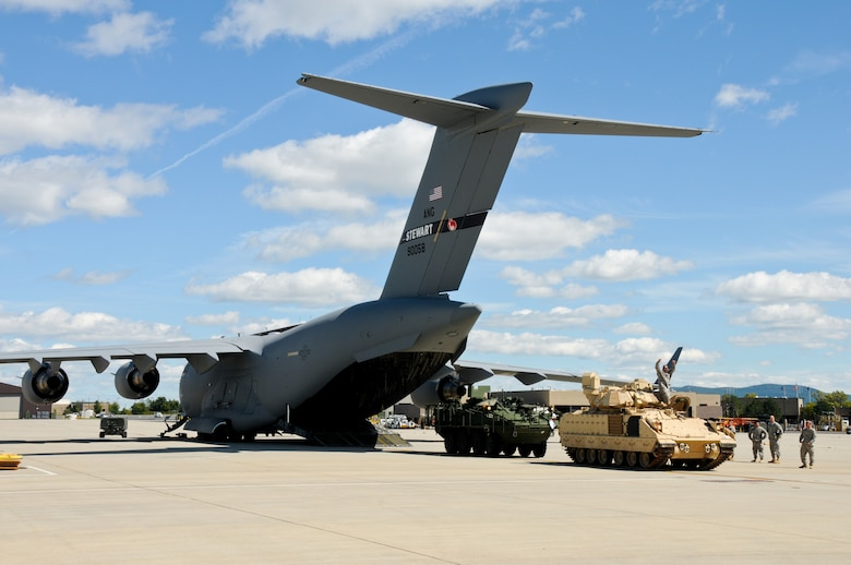 STEWART ANGB, Newburgh N.Y. --A Bradley fighting vehicle and Stryker fighting vehicle stationed at the end of a 105th Airlift Wing C-17 Globemaster III in