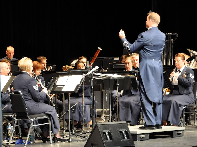 Capt. Jason Plosch, Air Force Band of the Golden West commander and conductor, leads the band through the opening score during a concert perfomance at the Sacramento Community Center Theater Oct. 9. (U.S. Air Force photo by Tech. Sgt. Eric Petosky/Released)
