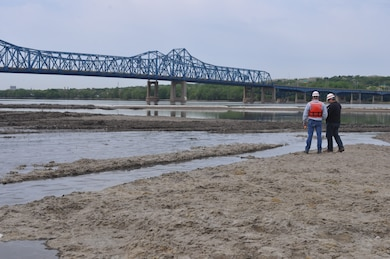 Corps employees look at the completed construction of the Peoria Upper Island project which is part of the Illinois River Basin Restoration.