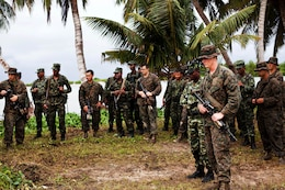 GAN, Republic of Maldives – Marines with Marine Deployment Unit 5 of the Maldivian National Defense Force and U.S. Marines with Company A, 1st Battalion, 4th Marine Regiment, observe a fire team of Maldivian Marines as they demonstrate entering a rally point here Oct. 9 as part of Exercise Coconut Grove 2012. Coconut Grove is a bilateral training exercise conducted bi-annually between the U.S. Marine Corps and the MNDF.