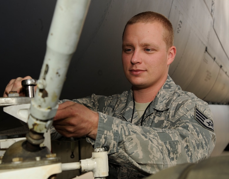 Staff Sgt. Joshua Crowe, 20th Aircraft Maintenance Unit hydraulics section, replaces a banana link on the main landing gear of a B-52H Stratofortress on Barksdale Air Force Base, La., Oct. 10. The flightline section of the hydraulics shop handles a much different sort of maintenance, such as red-ball, situations that occur during aircraft take-off that require immediate maintenance. (U.S. Air Force photo/Airman 1st Class Andrew Moua)(RELEASED)