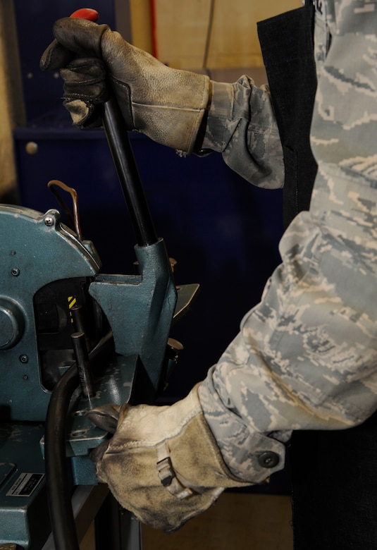 Senior Airman Richard Cota, 2nd Maintenance Squadron accessories flight hydraulics section, prepares to cut a hydraulic line on Barksdale Air Force Base, La., Oct. 9. The Airmen assigned to the hydraulics section are responsible for the maintenance of Barksdale's B-52H Stratofortress' hydraulic systems, which assist the aircraft in steering, landing and most importantly opening of the bomb-bay doors. (U.S. Air Force photo/Airman 1st Class Andrew Moua)(RELEASED)