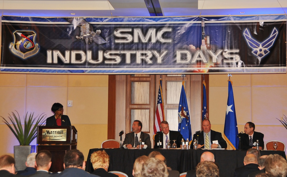 Doctor Wanda Austin, Aerospace Corporation president and CEO, moderates an industry panel discussion about meeting new challenges at SMC Industry Days, Oct. 3. Other panel members include Craig Cooning, Boeing Space and Intelligence Systems; Rick Ambrose, Lockheed Martin Space Systems Co.; Stan Dubyn, Millennium Space Systems; and Tom Wilson, ATK Space Division. (Photo by Sarah Corrice)