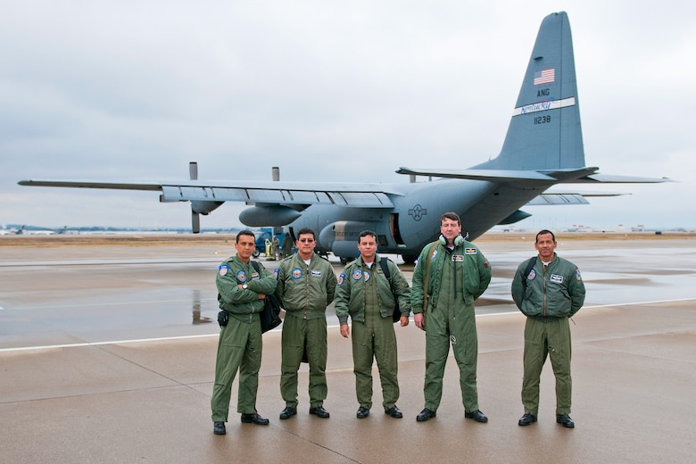 Five members of the Ecuador Air Force prepare to board a 123rd Airlift Wing C-130 for a local training flight at the Kentucky Air National Guard Base in Louisville, Ky., Feb. 16, 2012. The Airmen were in Kentucky as part of a National Guard State Partnership Subject Matter Expert Exchange. (U.S. Air Force photo by Master Sgt. Philip Speck.)
