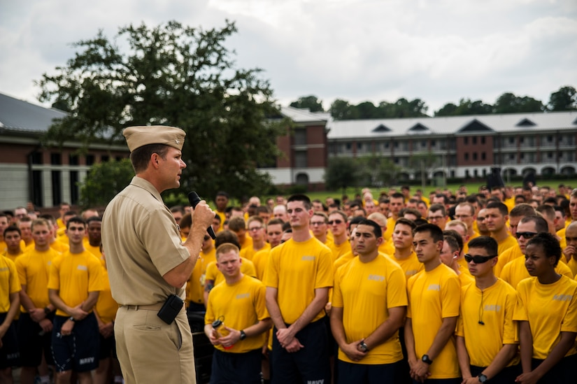 Capt. Jon Fahs, Naval Nuclear Power Training Command commanding officer speaks to hundreds of NNPTC students and faculty members before the beginning of a 5K race to help raise awareness of sexual assault Oct. 4, 2012, on the campus of NNPTC at Joint Base Charleston – Weapons Station, S.C.  Fahs explained to the students that sexual assault is a crime that will not be tolerated in today's military and emphasized shipmates need to take care of shipmates to help combat this crime. This is the second  5K run the NNPTC wardroom (officers) has sponsored. (U.S. Air Force photo/A1C George Goslin)
