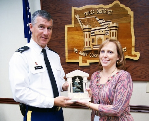 Raye Thornton, a paralegal with the Tulsa District U.S. Army Corps of Engineers' Office of Counsel, is presented the prestigious USACE Chief Counsel Keystone Award by District Commander Col. Michael Teague. The award recognizes professionalism and valued service of an individual member or of a team comprised of members of the USACE Legal Services System who made a significant contribution to the Corps Legal Services System and its mission.