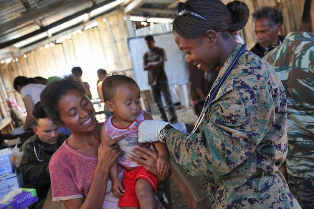 Lieutenant J.G. Francesca Harris, physician assistant, Combat Logistics Battalion 15, 15th Marine Expeditionary Unit, massages a child's arm after administering him a vaccine in a Timor-Leste village, Oct. 11. during Exercise Crocodilo 2012, the first exercise the 15th MEU and Peleliu Amphibious Ready Group has conducted during its Western Pacific deployment. During the exercise a total of 10 sights were visited in which corpsmen from the MEU  gave health screenings and vaccinations, made surgery referrals to a local hospital, provided dental care to include tooth removal, gave optometry screenings, prescribed and provided eyeglasses and issued medication and vitamins for minor illnesses or injuries.