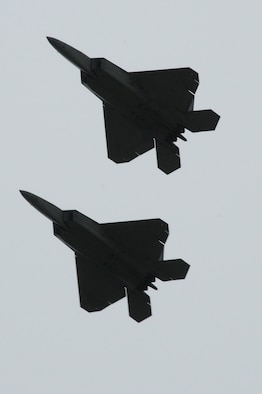 Two F-22 Raptors fly in formation during the 2012 Andersen Air Force Base Open House in Guam Oct. 13.  This year's open house is the first since 2009. (U.S. Air Force photo by Senior Airman Carlin Leslie/Released)