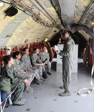 Maj.Dana Baker, 36th Medical Group aerospace medicine flight commander, accompanies her Airmen on an incentive flight Oct.11 here. The flight served as an opportunity for flight crew and medical personnel to interact with each other during mid-air refuelings. (U.S. Air Force photo by Airman 1st Class Mariah Haddenham/Released)