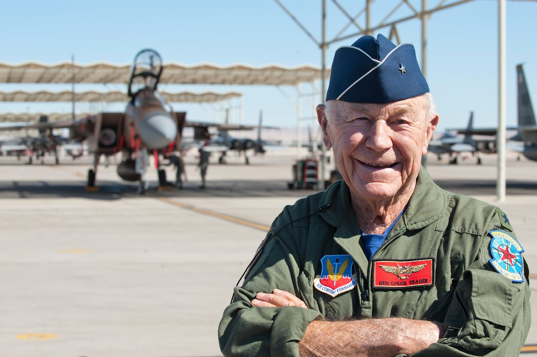 "Retired United States Air Force Brig. Gen. Charles E. ""Chuck"" Yeager poses for photographers after returning from his 65th anniversary of breaking the sound barrier flight aboard a 65th Aggressor Squadron F-15D Eagle piloted by Capt. David Vincent, 65th AGRS, at Nellis Air Force Base, Nev., Oct. 14, 2012. Yeager became the first man to break the sound barrier Oct. 14, 1947, over Edwards Air Force Base, Calif. (U.S. Air Force photo by Lawrence Crespo)"
